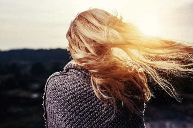 blond lady in the sunset