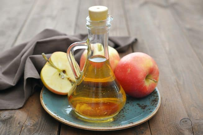 apple cider vinegar on plate