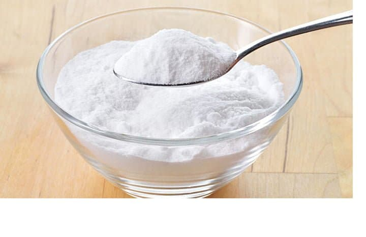 baking soda powder on spoon