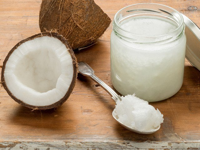 Coconut oil on spoon and jar