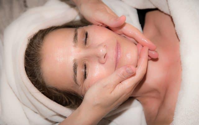 Woman receiving facial massage