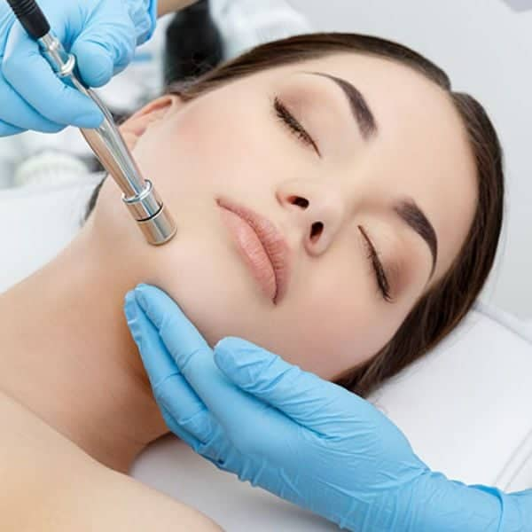 Woman undergoing microdermabrasion procedure