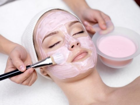 Woman Getting Facial Care For Dry Skin
