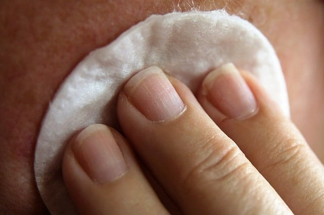 Cleaning skin with a cotton pad