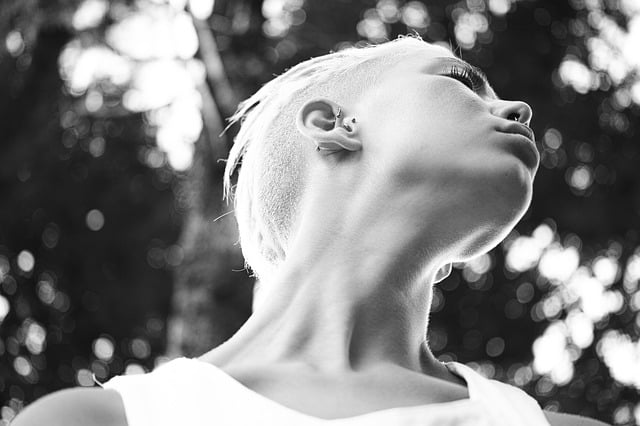 Black and white picture of a model and her showing off her neck