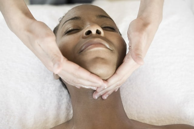 Woman getting spa treatment and massage at her neck area
