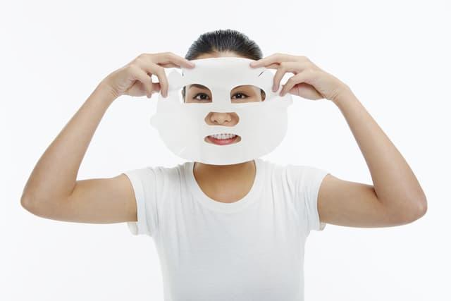 lady applying mask on face