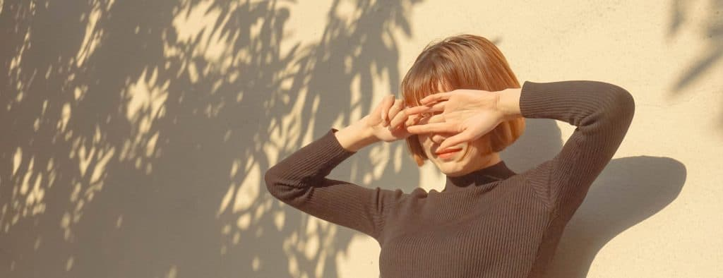 Woman Covering Her Face From Sunlight