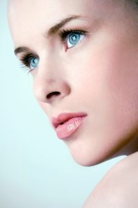 Microdermabrasion vs Hydrafacial Treatments - Woman with perfect complexion looking away from the camera