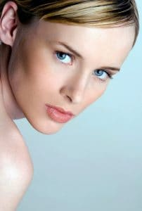 Microdermabrasion vs Hydrafacial? Woman with perfect skin complexion looking at the camera