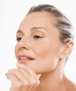 Middle age woman hand on chin