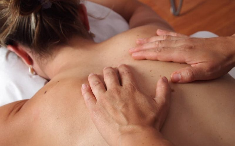 Woman with back acne getting treatment