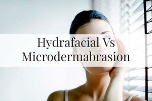 Woman thinking if she should go for hydrafacial or microdermabrasion treatment