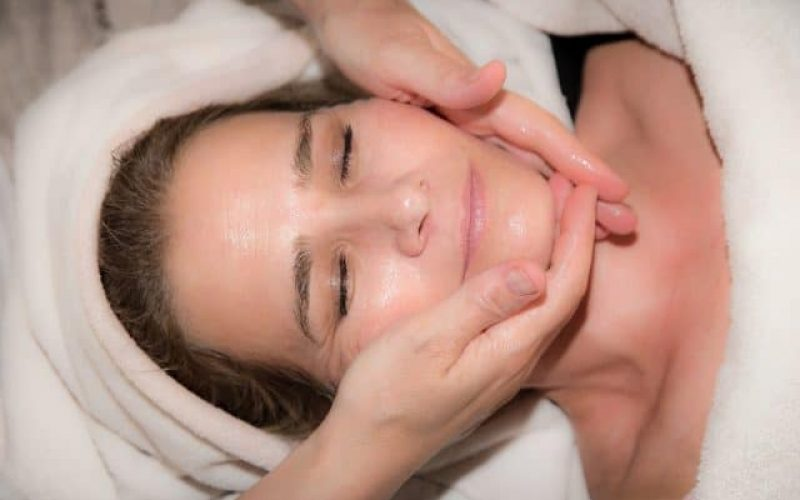 lady receiving face massage after facial treatment