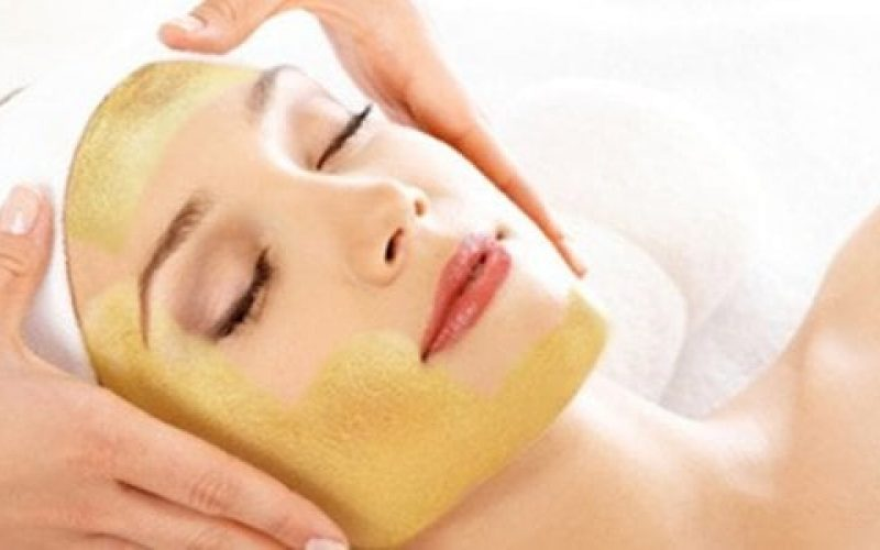 woman getting facial and massage for face and head